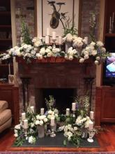 Mantle flowers and candles