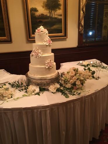Bridal bouquet placed by cake