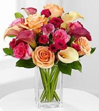 Mixed mini callas and roses in vase