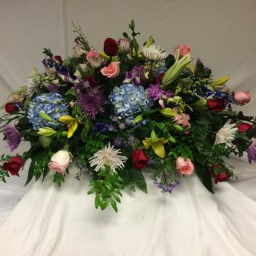 Casket cover of mix flowers with red roses