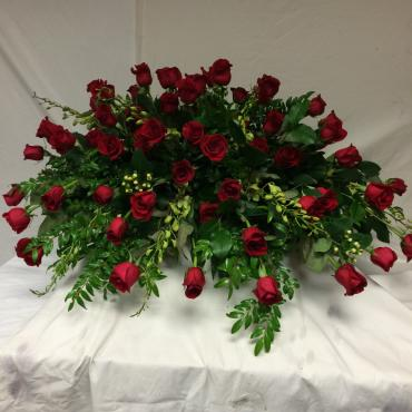 All roses with accents of green orchids